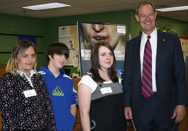 Trib Photo/Sue Tone<br> Arizona Attorney General Terry Goddard honors three Glassford Hill Middle School students who earned an honorable mention in a statewide poster contest through the Arizona Meth Project. From left are eighth graders Jessika Bystrom, Jacob Bryan, and Julia Lough, with AG Terry Goddard.