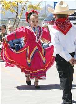 Trib Photo/Sue Tone Emily Godinez, 6, and Garrett Cummings, 6, perform as part of  Acorn Montessori School's Cinco de Mayo celebration on Monday.