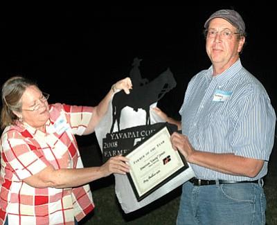 Yavapai County Farm Bureau Treas. Diana Kessler presents the Farmer of the Year award to Casey Jones of Hines Nurseries.<br> <i>TribPhoto/Heidi Dahms Foster</i>