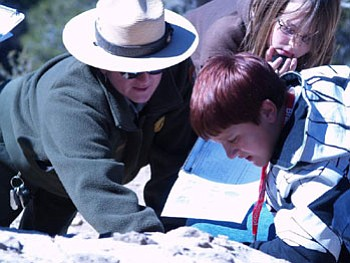Dustin Brown impresses Grand Canyon National Park Ranger Grossie with his knowledge about the canyon being 1 mile deep, 18 miles wide, and the Colorado River being 277 miles long during the BMMS student's recent field trip.<br> Courtesy Photo