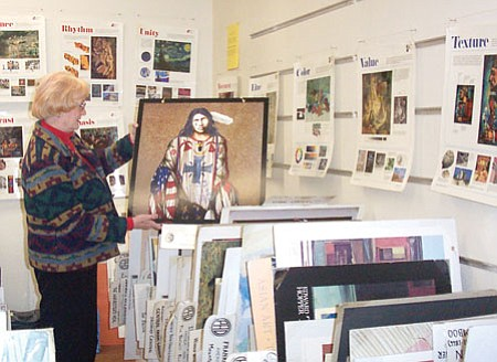 Prescott Art Docent Iyone Meyer pulls out one of 600 mounted posters in the PAD office in this Tribune file photo. The docents can draw upon the art posters, 1,000 art books and digital presentations when making their presentations to schools and groups.<br> Trib Photo/Sue Tone