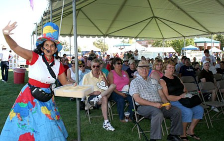 Persephone warms up the crowd at this past year's World Arts Festival. She returns on Sept. 12 to entertain the crowds with her humor and music, and also will hand out awards for the winners of the PV Art Guild's sale and show.<br> Trib File Photo/Sue Tone