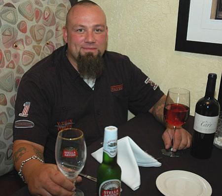 Christopher Martin awaits new customers at Rustica Bistro and Wine Bar in Prescott Valley.<br> TribPhoto/Cheryl Hartz