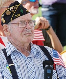 Prescott Valley resident and WWII veteran Keith Staker, who is a member of the Arizona Veterans Hall of Fame, listens to the program at the 2008 Patriot's Day ceremony at the PV Civic Center. The community will again gather on Friday to remember those who lost their lives on Sept. 11, 2001, and those who have served their country since.<br> Trib File Photo/Cheryl Hartz
