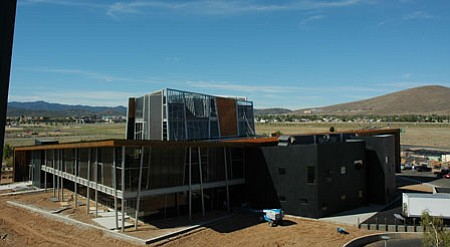 The new Prescott Valley Public Library, viewed here from the top of the Civic Center, will open on Saturday, Oct. 10. It will feature an Onsite Caf&#233;, Virtual Interactive Room, Friends of the Library Book Store/Gift Shop, drive-up window, study areas, 200-Seat performance theatre and Council chambers, Crystal Meeting Room, two fireplaces, 300-space parking lot, observation terrace, children's interactive wall, as well as adult and teen patios.<br> TribPhoto/Cheryl Hartz
