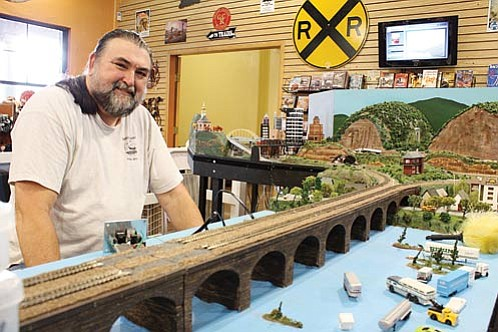 Larry Davis, with the Prescott Valley N-Trak Club, displays his work at the Grand Canyon Railway.<br> Photo courtesy of Ryan Williams/WGCN