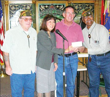 VFW Post 10227 members present Jasmine and Glen Crowl with a check to mail the boxes<br> Photo courtesy Jasmine Crowl