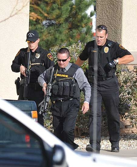 Officers leave the Country Bank on Glassford Hill Road Friday afternoon after responding to a report of a robbery at gunpoint. Police are looking for a male suspect. <br>Photo courtesy Les Stukenberg