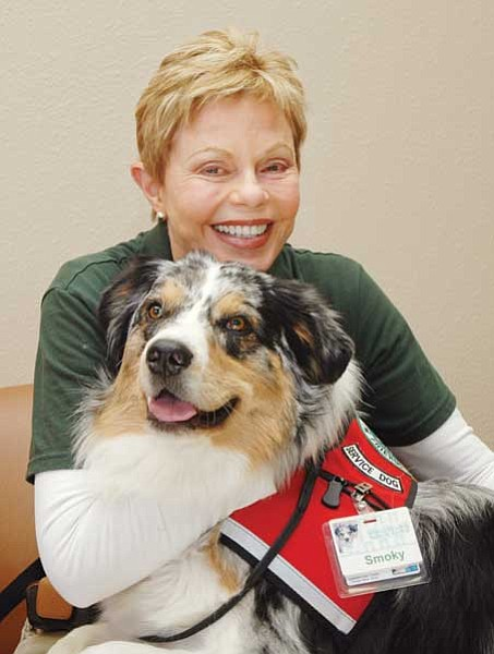 "Toni Tennille poses with her Australian Shepherd therapy dog, ""Smoky."" The duo have been paying visits to Yavapai Regional Medical Center patients. <br>Heidi Dahms Foster/TribPhoto"