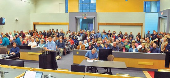 Prescott Valley residents fill the council chambers Thursday night, Jan. 28, during a Town Council meeting in Prescott Valley. Representatives from Elliot D. Pollack and Co. discussed the economic impact the proposed private prison could have on Prescott Valley. Many residents spoke, mostly in opposition to the prison, in the public comment session at the end of the meeting. Those in favor of the prison say the public process has been halted by council actions.<br> Photo courtesy Matt Hinshaw