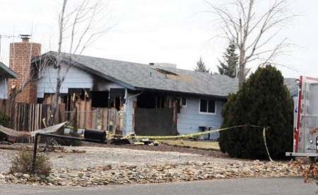 Two people and a cat died in this house fire that occurred Wednesday morning in the 4200 block of Kearny Drive in Prescott Valley. Photo courtesy of Les Stukenberg/The Daily Courier