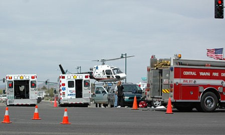 An Omniflight helicopter lands on Navajo Drive in Prescott Valley Saturday afternoon following a 4-vehicle crash at the intersection with Hwy. 69.<br> TribPhoto/Cheryl Hartz