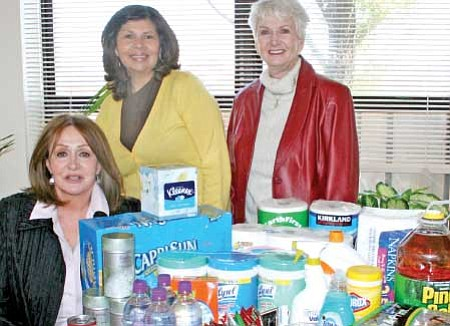 The Yavapai Chapter of the Daughters of the American Revolution donate goods to the Yavapai Family Advocacy Center in Prescott Valley after getting ideas from the Center's Wish List. From left, Kathy Machmer, Yavapai Chapter Regent DAR, YFAC Victim Advocate Laura Garcia, and past DAR Regent Dorothy Castanos. Trib Photo/Sue Tone