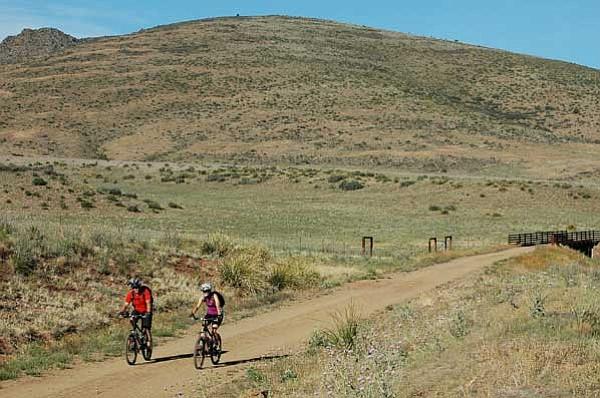 Newlyweds Bill and Sally Thompson bike the Iron King Trail in Prescott Valley on June 4, 2010. Photo by Cheryl Hartz