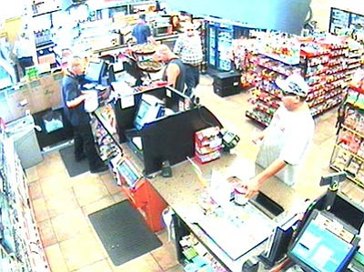 Security video captured the alleged theft of can containing donations for Emmett Trapp's family.<br> PVPD/Courtesy photo