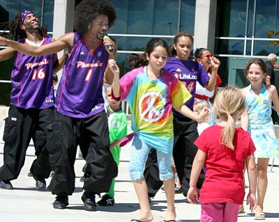 Members of the Phoenix Suns hip-hop dance team performed at this past year's World Arts Festival and invited members of the audience on stage for a quick dance lesson. Come enjoy many performances, artists, and craft activities again this year at the free Fall for the Arts event at Tim's Toyota Center on Oct. 9. <br>File photo/Sue Tone