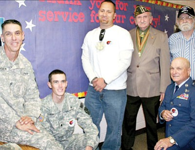 Third-graders at Mountain View Elementary School got a visit from six veterans and servicemen on Wednesday, when they learned about service in several military branches. From left, Jonathan Snyder and Christopher Triem with the Arizona Army National Guard, Dennis Brown, Clyde Kincaid, Joe Ward (kneeling), and Raleigh Rhone.<br> TribPhoto/Sue Tone