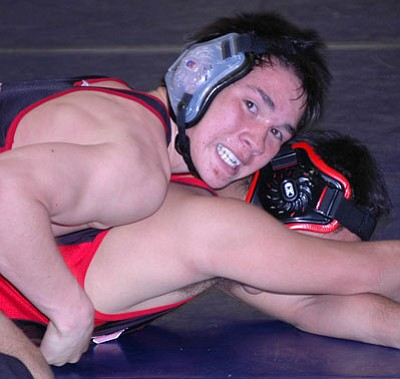 Bradshaw Mountain's Tomas Medevielle takes down an opponent in earlier season action.<br> TribPhoto/Cheryl Hartz