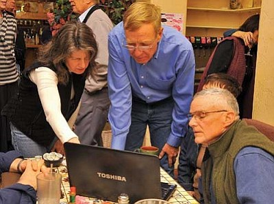 Photo courtesy Matt Hinshaw<br> From left, Town Council Candidate Mary Mallory, Tom Thurman District 2 Supervisor, and Don Packard look at the first round of results from the Prescott Valley Town Council election Tuesday night at Olivas Mexican Food restaurant.