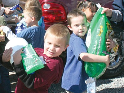 Kindergartners from Coyote Springs Elementary School help deliver food, toys, towels and other items to the Yavapai Humane Society on March 7 to give back to the community.<br> Trib Photo/Sue Tone