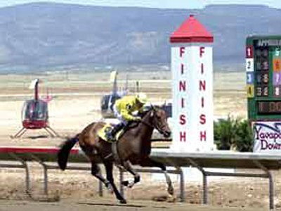 Moe Mentum, with jockey Orlando Martinez up, was the winner of the inaugural race at Yavapai Downs in Prescott Valley on May 26, 2001.<br> File photo courtesy The Daily Courier