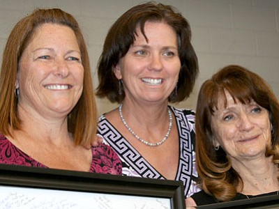 Lake Valley Elementary School Principal Tusanne Cordes, center, is losing two veteran teachers to retirement - Sheryl Slothower, left, and Joy Guyer. Cordes honored the teachers at an assembly on May 17.<br> Trib Photo/Sue Tone