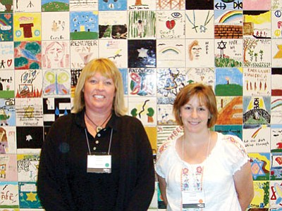 Mardi Read, left, Granite Mountain Middle School teacher, and June Lombardi, Bradshaw Mountain High School teacher, stand in front of the Children's Tile Wall at the Holocaust Museum in Washington, D.C., during a training conference in June 2009. The Jewish Community Foundation of Greater Prescott honored both teachers on May 3 during the Days of Remembrance program at the Yavapai College Performance Hall.<br> Courtesy Photo