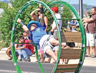 A young acrobat entertains along the parade route during the 2011 Prescott Valley Days Parade. The parade begins on Robert Road at Yavapai and ends at Mountain Valley Park.<br> File Photo
