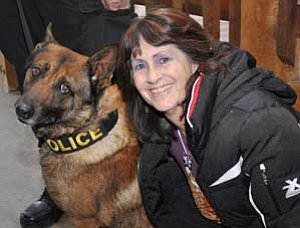 Prescott Valley Animal Control Officer Robin Petrovsky mugs with the recently retired Joey. <br>Photo by Heidi Dahms Foster
