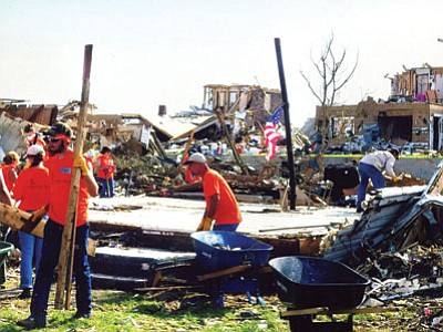 A volunteer crew from the Prescott/PV area helps to clear a home of debris in the tornado-devastated Joplin, Miss., area.<br> Courtesy Photo/Warren Micale