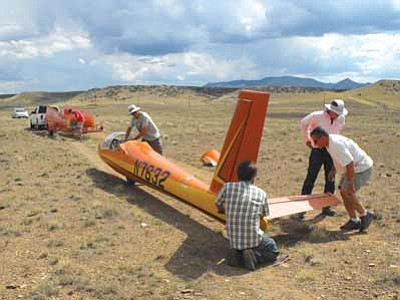 Members of the Prescott Soaring Club remove the wings and tail from the glider and prepare to put it on a trailer to take it back to the airfield on Sunday.<br> Photo courtesy Scott Orr