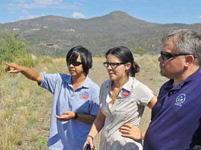 Monika O'Sullivan, left, Superfund Remedial Project Manager, Margot Perez-Sullivan, a Public Information Officer with the EPA, and Jeff Dhont, also a Superfund Remedial Project Manager, talk about the future clean-up of the Iron King Mine and the Humboldt Smelter Tuesday afternoon while touring the sites in Dewey-Humboldt.<br> Photo courtesy Matt Hinshaw