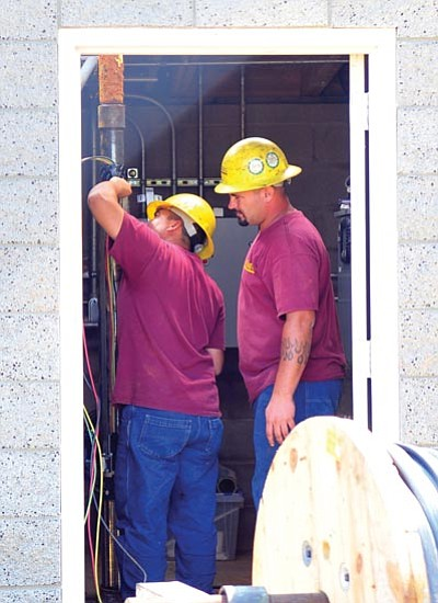 Employees from the Weber Group install a new pump at the Mingus West Pump Station in Prescott Valley Friday morning.<br> Photo courtesy Les Stukenberg