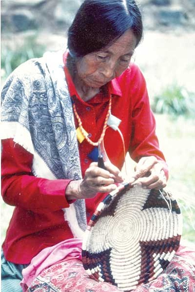 Angelita Torres Carillas, a Seri Indian from Baja Mexico, works on a basket in this undated photo. Members of the Seri tribe will display and sell their crafts, including baskets, shell and rattlesnake vertebra necklaces, at the Agua Fria Festival on Oct. 8-9 in Dewey-Humboldt.<br> Courtesy Photo