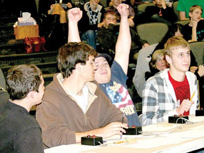 Another winning answer for the Bradshaw Mountain High School College Bowl team competing at the NAU-Yavapai County Mathematics Competition Jan. 26 at Embry-Riddle Aeronautical University. From left are Josh Sanderson, Ryan Madler, Joey Cilano and Austin Kent.<br> Trib Photo/Sue Tone