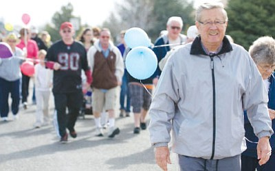 Prescott Valley Mayor Harvey Skoog leads the 2011 March for Meals to raise money for Meals on Wheels.<br> File Photo/Les Stukenberg