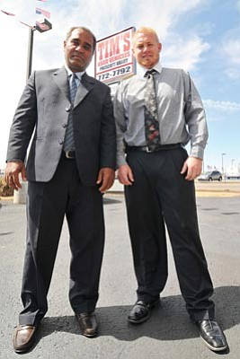 General Manager of Tim's Auto Group Ali Hussain, left, and Used Car Manager Robby Hinshaw pose at the newly reopened Tim's Used Vehicles lot in Prescott Valley.<br> Photo courtesy Les Stukenberg