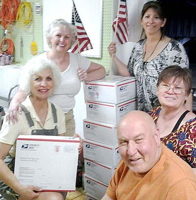 From left, Julie Poole, Rebecca Leatherwood, Laura Sutton, Paulette Martone, and Augie Martone pose near their filled boxes.<br> Courtesy Photo
