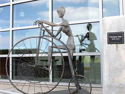 Velocipede Rider by Barbara Andress stands outside the north third floor entrance to the Prescott Valley Civic Center. The artist has offered the steel sculpture to the town's permanent art collection.<br> Trib Photo/Sue Tone