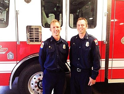 Newly promoted Central Yavapai Fire District Capt. Damian Lys, left, and Capt. Zach Pederson, right, pose at the Central Yavapai Regional Training Center after they were promoted from engineers during the June 18 board meeting in Prescott Valley.<br> CYFD/Courtesy photo