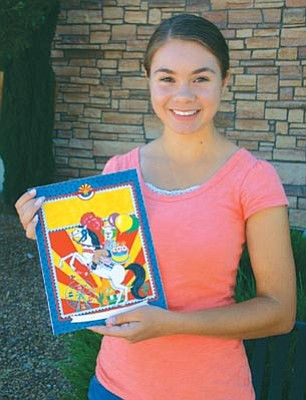 Shalom Eis, 16, of Dewey, shows off her drawing that will appear on the cover of the Yavapai County Fair 2012 Premium Book.<br> Photo courtesy Lisa Irish