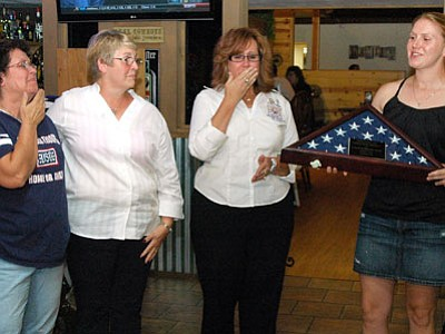 Karen Berggren presents an American flag that flew over Bagram Airfield in Afghanistan by Combined Joint Task Force Paladin this past Mother's Day, May 13, 2012, in honor of Central Arizona Blue Star Moms, to chapter representatives, from left: financial secretary Rose Krutcher, Doreen Berggren (her own mom) and Lisa Collins, president.<br> Trib Photo/Cheryl Hartz