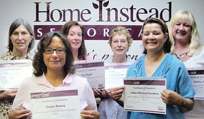 Caregivers with Home Instead Senior Care earned certificates after completing training in interactive care with patients of Alzheimer's disease and other dementias. From left are Catherine Roberts, Debbie Ramsey, Amy Skeel, Audrey Rodgers, Helen Mendoza, and &#8232;Client Care Manager Caroline Pruett.<br> Courtesy Photo