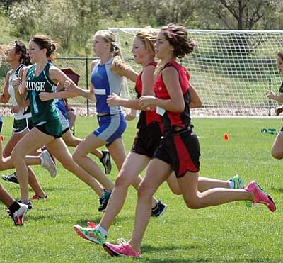 Bradshaw Mountain High cross country runners Hannah Madler, front, and Chelsea McKenna, start the race of the Nos. 2 and 3 together Saturday at the Ray Wherley Invitational at the Embry-Riddle Aeronautical University campus in Prescott.<br> TribPhoto/Cheryl Hatrz