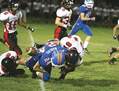 A hard hit by Bradshaw's  Nick Martensen, right, knocks the ball loose from Cougar wide receiver Tory Marciel during the Bears' 48-0 win in Chino Valley Friday night.<br> Photo Courtesy Matt Santos