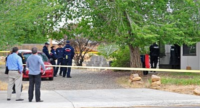 Prescott Valley police officers survey the scene of a double homicide inside a home near the intersection of Robert Road and Lakeshore Drive in Prescott Valley Thursday afternoon.<br> Photo courtesy Matt Hinshaw