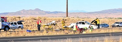 TribPhoto/Matt Santos<br /><br /><!-- 1upcrlf2 -->Emergency personnel work the scene of a reported one-vehicle rollover accident on Highway 89A near Glassford Hill Rd. Sunday afternoon.