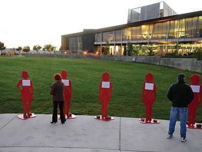 Life-size cutouts of Arizona women who died as a result of domestic violence were on display at the Take Back the Night ceremony and vigil at the Prescott Valley Civic Center Wednesday night.<br> Photo courtesy Les Stukenberg
