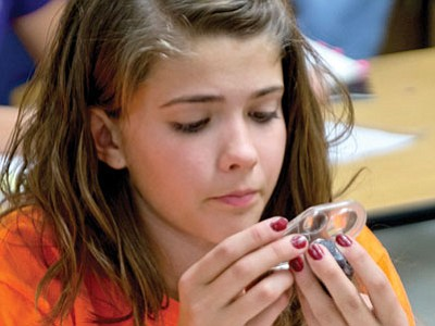 GHMS student Taidyme Routh studies a rock sample in the Rocks and Minerals portion of the Northern Arizona Invitational Science Olympiad competition this past Saturday at Glassford Hill Middle School.<br> Courtesy Photo/Cheryl Taylor