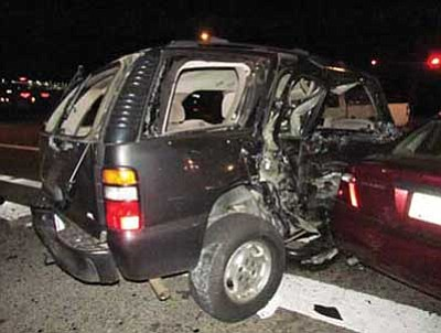The driver of a white Chevy pickup truck collided with a dark-colored Chevy Tahoe Sunday evening at the intersection of Highway 69 and StoneRidge Drive in Prescott Valley.<br> Photo courtesy PVPD
